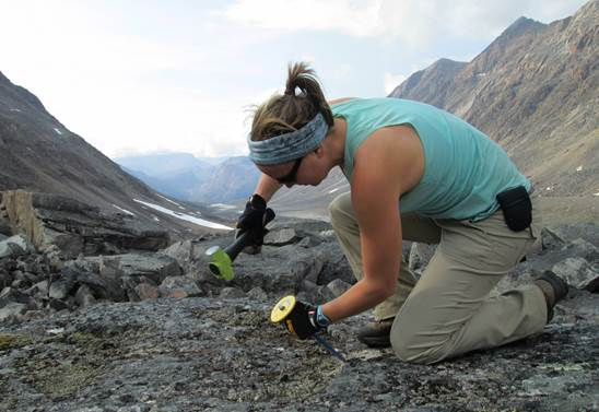 Sarah collecting a glacier moraine sample on Baffin Island, Arctic Canada