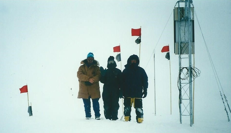 REU participant Elaine Godfrey (center) and teammates at the top of the Greenland ice cap after successfully repairing a magnetometer