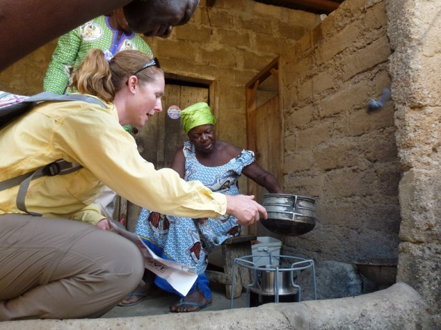 Here I am in Northern Ghana working with a woman to test a new, more efficient stove that is expected to produce less smoke than her traditional stove.